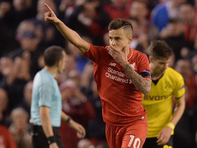 Philippe CoutinhooooOOOOoo celebrates pulling one back during the Europa League quarter-final between Liverpool and Borussia Dortmund on April 14, 2016