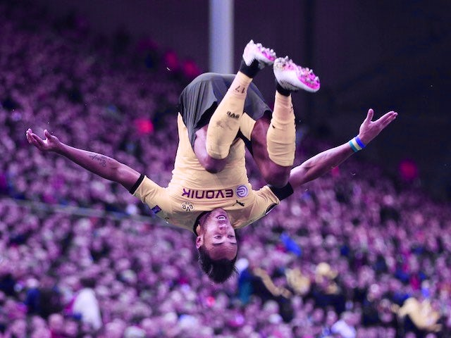 Pierre-Emerick Aubameyang celebrates scoring the second during the Europa League quarter-final between Liverpool and Borussia Dortmund on April 14, 2016