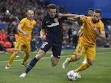 Saul Niguez and Jordi Alba in action during the Champions League quarter-final between Atletico Madrid and Barcelona on April 13, 2016