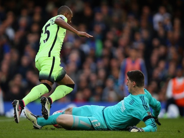 Thibaut 'hi kev!' Courtois brings down Fernandinho during the Premier League game between Chelsea and Manchester City on April 16, 2016