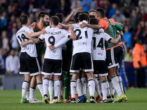 Valencia survive Real siege to clinch win