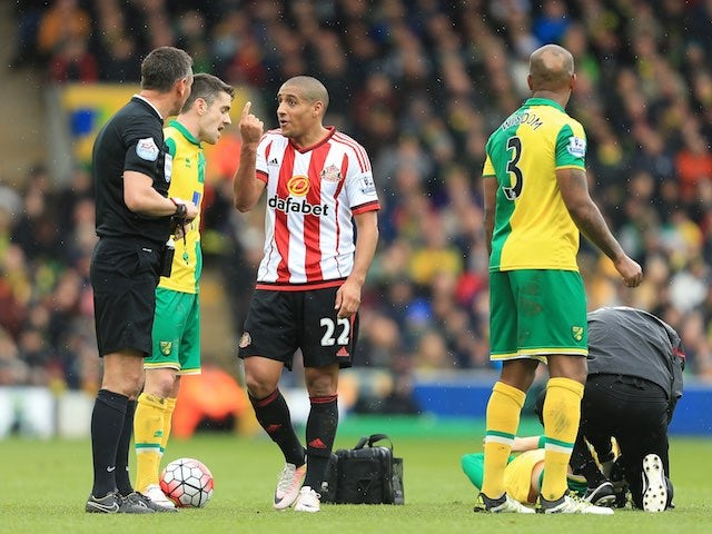 Wahbi Khazri talks to referee Andre Marriner during the Premier League game between Norwich City and Sunderland on April 16, 2016