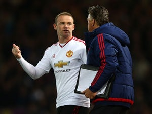 Wayne 'have you got change for a twenty?' Rooney has a chat with Louis van Gaal during the FA Cup replay between West Ham United and Manchester United on April 13, 2016