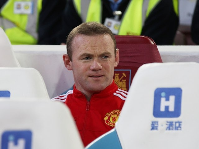Wayne Rooney watches from the bench during the FA Cup replay between West Ham United and Manchester United on April 13, 2016