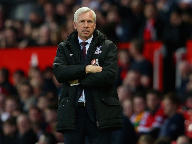 Alan Pardew is on the defensive during the Premier League game between Manchester United and Crystal Palace on April 20, 2016