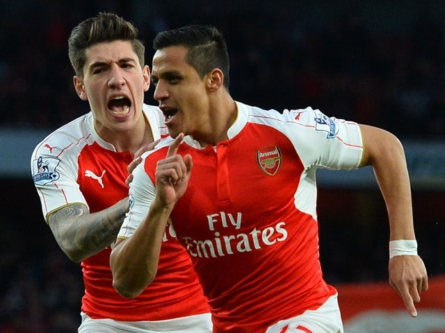 Alexis Sanchez celebrates with Hector Bellerin after scoring the opening goal during the Premier League match between Arsenal and West Bromwich Albion on April 21, 2016