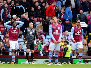 Aston Villa players are depressed during the Premier League game against Southampton on April 23, 2016