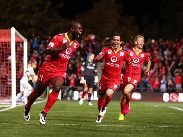 Bruce Djite of Adelaide United celebrates with teammates after scoring a goal during the A-League semi-final against Melbourne City at Coopers Stadium on April 22, 2016