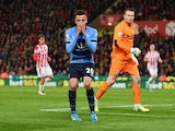 Dele Alli reacts after hitting the woodwork during the Premier League game between Stoke City and Tottenham Hotspur on April 18, 2016