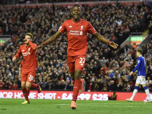 Divock Origi celebrates scoring during the Premier League game between Liverpool and Everton on April 20, 2016