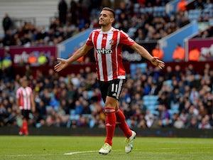 Tadic double helps Saints edge out Villa
