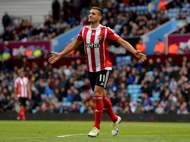 Dusan Tadic celebrates scoring during the Premier League game between Aston Villa and Southampton on April 23, 2016