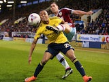 A tussle ensues when Emilio Nsue tries to ward off Stephen Ward during the Championship clash between Burnley and Middlesbrough at Turf Moor on April 19, 2016