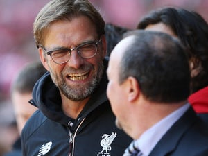 Benitez's Newcastle peg back Reds to earn point