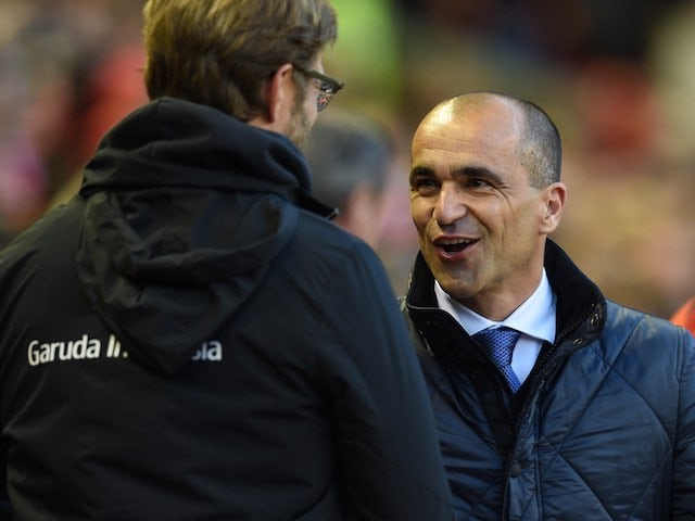 Jurgen Klopp and Roberto Martinez greet each other prior to the Premier League game between Liverpool and Everton on April 20, 2016