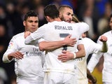Karim Benzema celebrates scoring with Cristiano Ronaldo during the La Liga game between Real Madrid and Villarreal on April 20, 2016