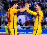Lionel Messi celebrates with Luis Suarez after getting on the scoresheet for the sixth during the La Liga game between Deportivo La Coruna and Barcelona on April 20, 2016