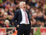 Mark Hughes reacts during the Premier League game between Stoke City and Tottenham Hotspur on April 18, 2016