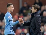 Mauricio Pochettino congratulates Dele Alli during the Premier League game between Stoke City and Tottenham Hotspur on April 18, 2016