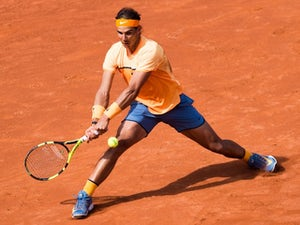 Nadal thumps compatriot to reach quarters