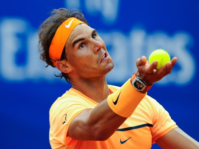 Rafael Nadal serves against Fabio Fognini during day five of the Barcelona Open on April 22, 2016