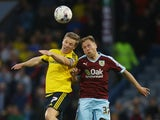 Grant Leadbitter and Scott Arfield contest an aerial duel in the Championship match between Burnley and MIddlesbrough at Turf Moor on April 19, 2016