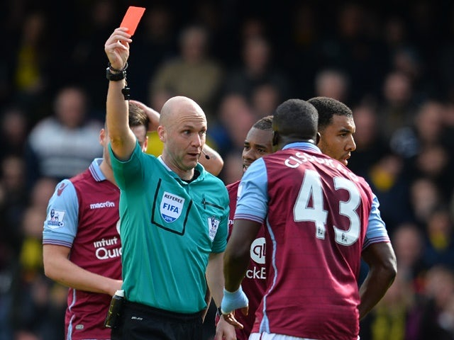 Aly Cissokho is shown the red card by Anthony Taylor during the Premier League match between Watford and Aston Villa on April 30, 2016
