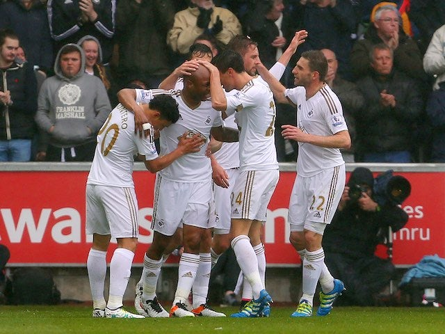 Result: Swansea cruise past 10-man Liverpool