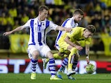 Asier Illarramendi and David Zurutuza vie with Samuel Castillejo during the La Liga match between Villarreal and Real Sociedad at El Madrigal stadium in Villareal on April 24, 2016