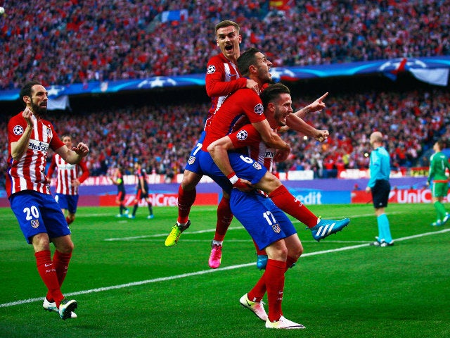 Atletico Madrid players celebrate after Saul Niguez gives them the lead against Bayern Munich in their Champions League semi-final on April 27, 2016
