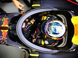 Daniel Ricciardo sits in his Red Bull-TAG Heuer RB12 fitted with the aeroscreen during previews ahead of the Formula One Grand Prix of Russia at Sochi Autodrom on April 28, 2016