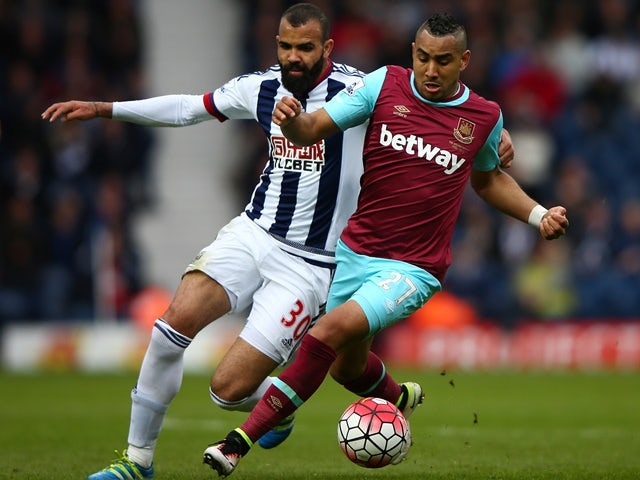 Dimitri Payet and Sandro in action during the Premier League match between West Bromwich Albion and West Ham United on April 30, 2016