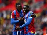 Emmanuel Adebayor and Bakary Sako celebrate their team's victory following the FA Cup semi-final between Watford and Crystal Palace at Wembley Stadium on April 24, 2016
