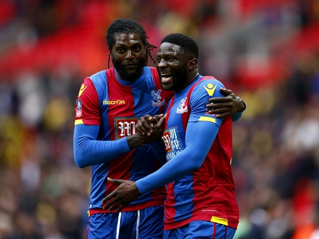 Emmanuel Adebayor and Bakary Sako celebrate their team's victory following the FA Cup semi-final between Watford and Crystal Palace at Wembley Stadium on April 24, 2016