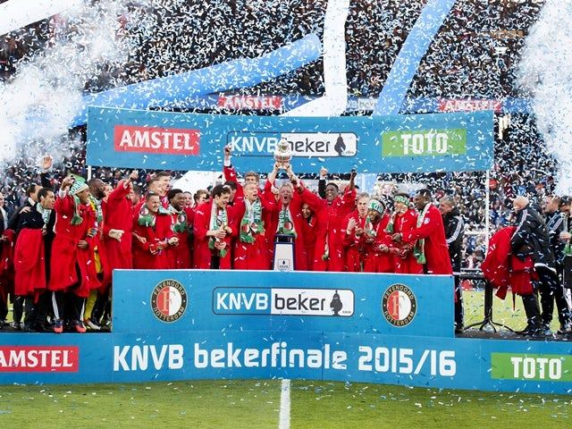 Feyenoord's players celebrate with the trophy on the podium after winning the Dutch cup final football match against FC Utrecht on April 24, 2016