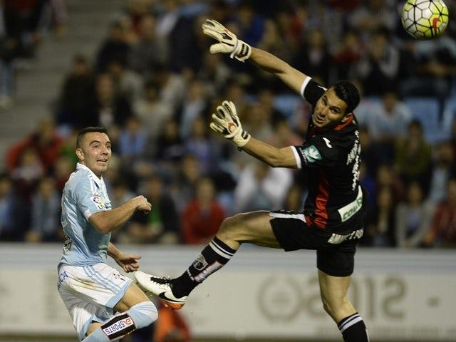 Iago Aspas scores his second goal over goalkeeper Andres Fernandez during the La Liga match between Celta Vigo and Granada on April 25, 2016