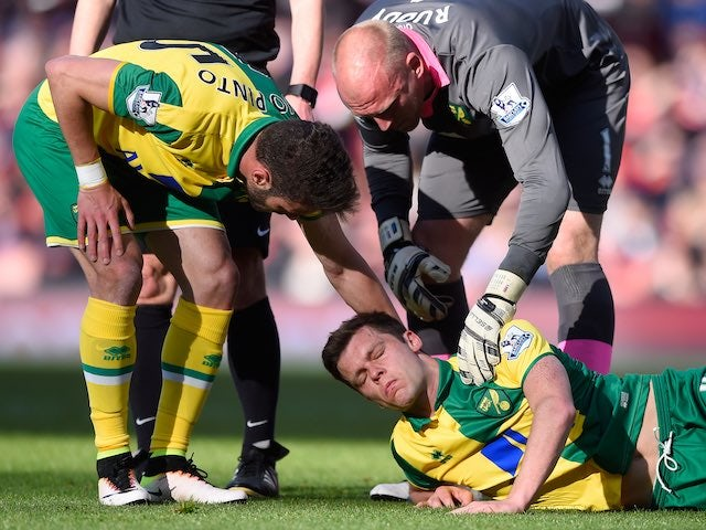Ivo Pinto and John Ruddy console Jonny Howson during the Premier League game between Arsenal and Norwich City on April 30, 2016