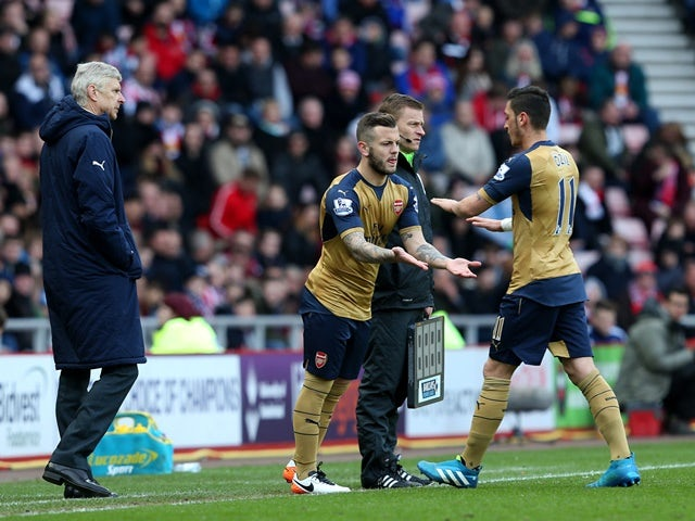 Jack Wilshere replaces Mesut Ozil as a substitute during the Premier League match between Sunderland and Arsenal at the Stadium of Light on April 24, 2016
