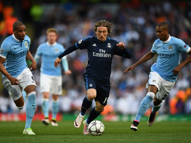 Luka Modric of Real Madrid is flanked by Manchester City pair Fernando and Fernandinho during the Champions League semi-final first leg on April 26, 2016