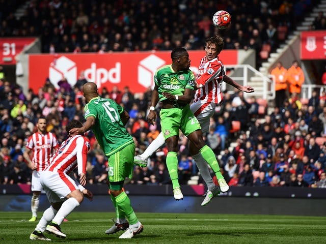 Peter Crouch outjumps Lamine Kone during the Premier League match between Stoke City and Sunderland on April 30, 2016