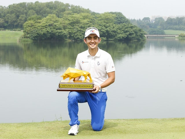 Soomin Lee of South Korea holds the trophy after winning the Shenzhen International at Genzon Golf Club on April 25, 2016