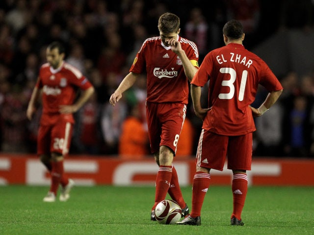 Liverpool legends Steven Gerrard and Nabil El Zhar look disappointed following their Europa League semi-final exit at the hands of Atletico Madrid in 2009-10