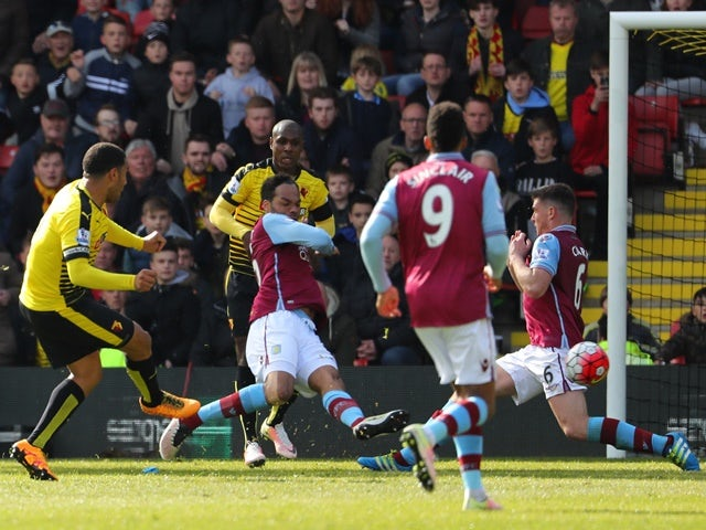 Troy Deeney scores his side's third goal during the Premier League match between Watford and Aston Villa on April 30, 2016
