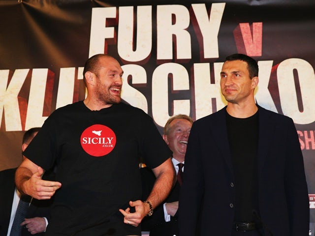 Tyson Fury dances alongside Wladimir Klitschko during their head-to-head press conference at Manchester Arena on April 27, 2016