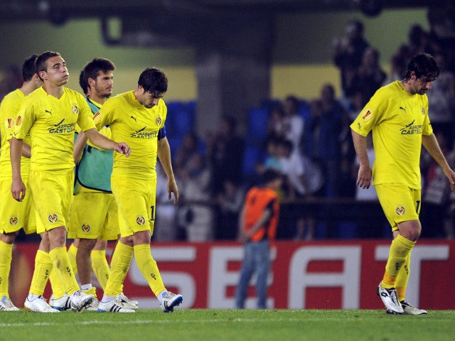 Villarreal's players look disappointed after losing in the 2010-11 Europa League semi-final