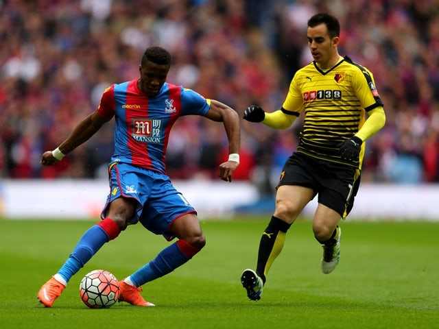 Wilfried Zaha of Crystal Palace is watched by Jose Manuel Jurado of Watford during the FA Cup semi-final on April 24, 2016