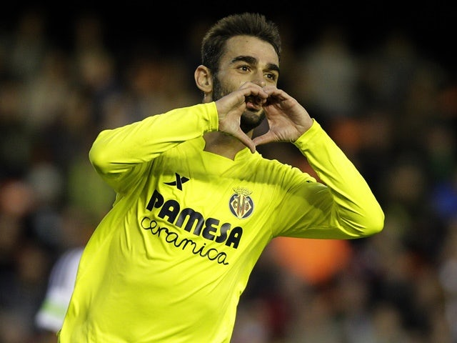 Adrian Lopez celebrates his goal during the La Liga match between Valencia and Villarreal  at the Mestalla stadium on May 1, 2016