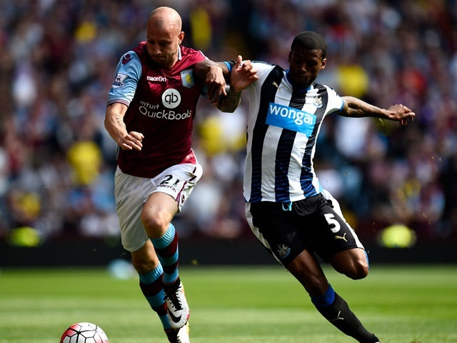 Alan Hutton and Georginio Wijnaldum in action during the Premier League match between Aston Villa and Newcastle United on May 7, 2016
