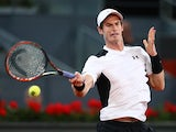 Andy Murray hits a forehand during the men's singles quarter final match against Tomas Berdych at the Mutua Madrid Open on May 6, 2016