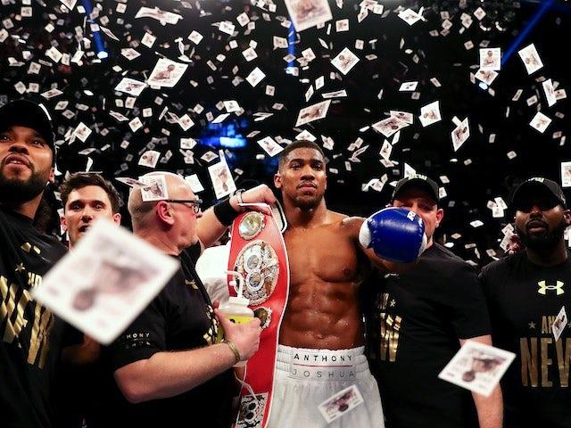Anthony Joshua celebrates winning the IBF world heavyweight title on April 9, 2016